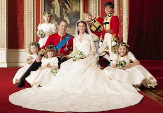 William, Kate and the wedding party pose for a playful photograph in the Throne Room at Buckingham Palace.