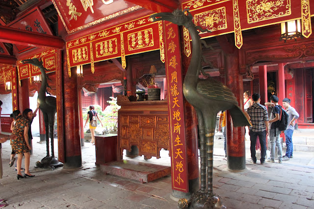 In Vietnamese culture, touching the turtle or crane by hand and hoping to endure  longevity or power respective at Temple of Literature in Hanoi, Vietnam