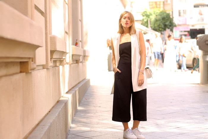 Black jumpsuit, white vest