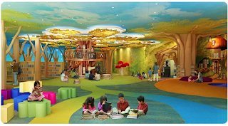 library features children reading with trees on the walls and books all over the room