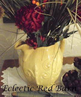 vintage yellow vase with fall flowers