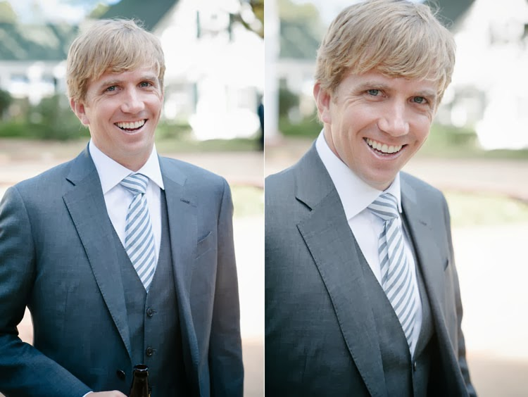 groom laughing with having his portrait taken