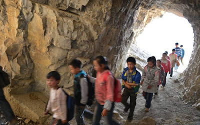 The footpath is cut through the cliff face at points. It is less than 0.5 metres wide in places so the children have to walk single file and press themselves into the side of the mountain is someone wants to squeeze past. According to headmaster Xu Liangfan the school has 49 students.Picture: HAP/Quirky China News / Rex Features
