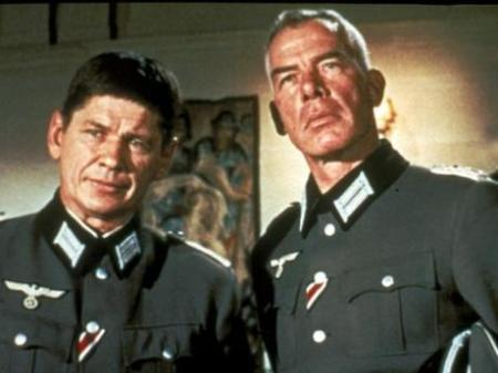 Charles Bronson and Lee Marvin dressed as German Luftwaffe officers in The Dirty Dozen movieloversreviews.blogspot.com