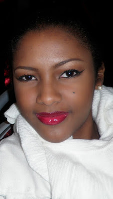 GlamorousGia makeup look for valentines day on dark skin, red lips and a classic eyeliner.