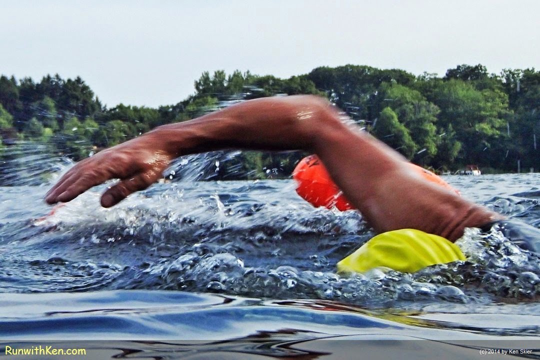 Up-close action photo of a triathlete open water swimming at Lake Singletary in Sutton, MA. Sports Photography from Inside the Pack by Ken Skier, the Swimming Photographer. (RunwithKen.com)