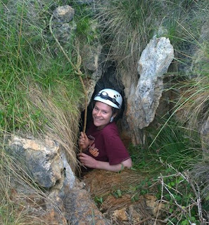 Laura entering the cave; getting in and out is a tight squeeze!