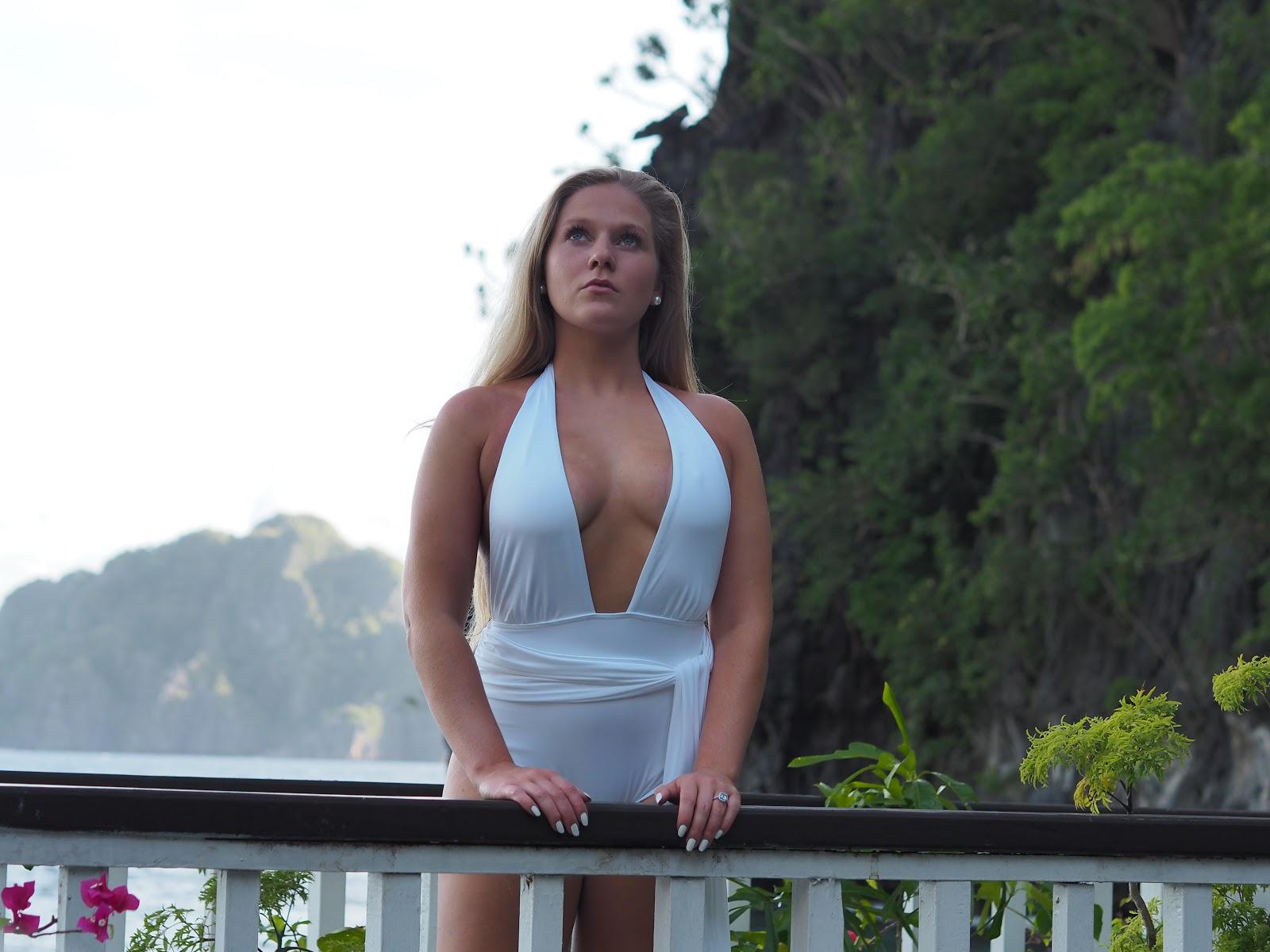 Blonde girl in white swimsuit