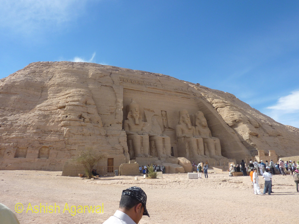Tourists around the entry door to the Abu Simbel temple in Egypt