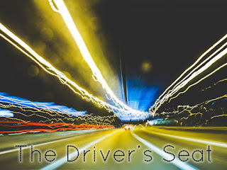driver's seat logo: long exposure shot of a nighttime street