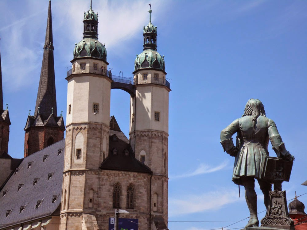 Statue of Handel, looking at the Marktkirche Unser Lieben Frauen in Halle (Saale)