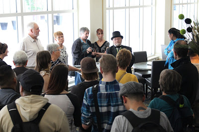 Guide and HW Board Member Greg Agnew (in the top hat) give a tour at the Metropolitan Entertainment Centre.
