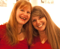 Photo of Robin and Sheila in Red Dresses