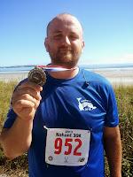 Image: Lance holding finishing medal.