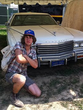 Jamin Orrall next to Neil Young's caddy