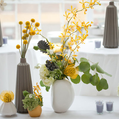 Modern yellow and gray wedding centerpieces Whether your wedding style is