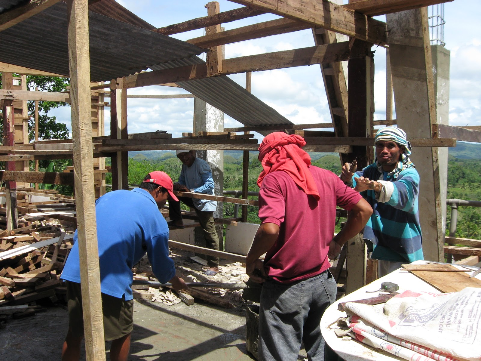 Filipino men at work high risk labor for less dead man - Carpenter funds administrative office ...