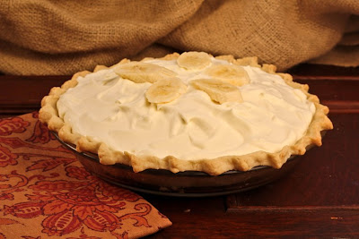 banana cream pie on wood table