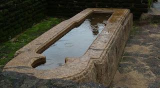 Granite stone sarcophagus bath tub, ancient hospital Polonnaruwa, Sri Lanka