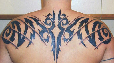 Black tribal upper back tattoo