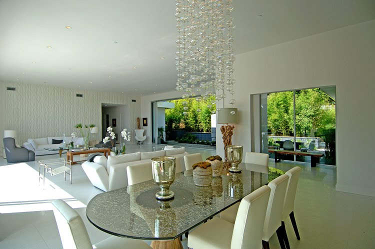 See this house setting the stage for a house with a view for Dining table in living room pictures