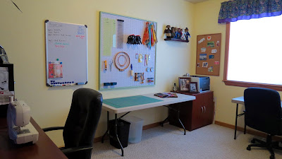 sewing room with pegboard