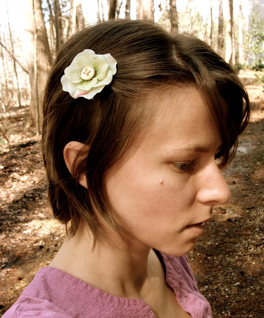 short hair style with green flower clip off to one side