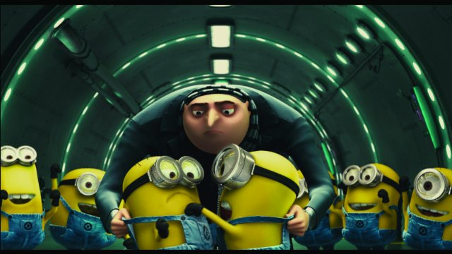 Gru watching his minions in Despicable Me animatedfilmreviews.blogspot.com