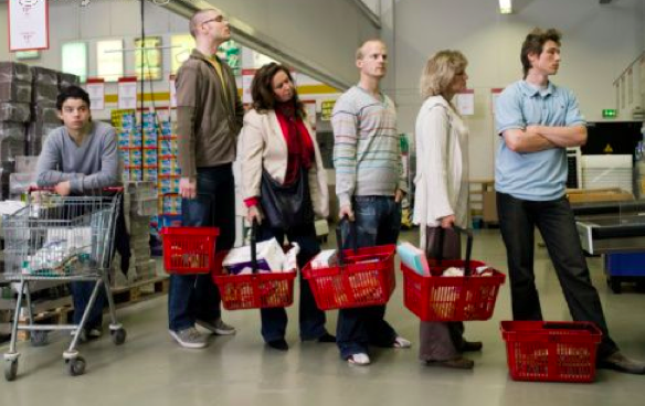 Aldi Market Customers Waiting in Long Lines