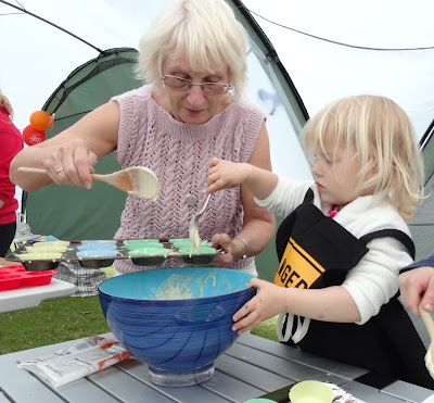 Tin Box Tot making cakes with grandma