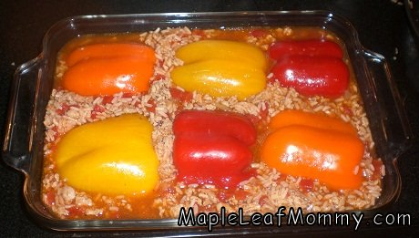 Adding the sweet peppers to the rice mixture.