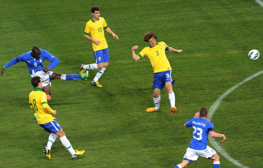 Italy forward Mario Balotelli scores the equalizing goal against Brazil