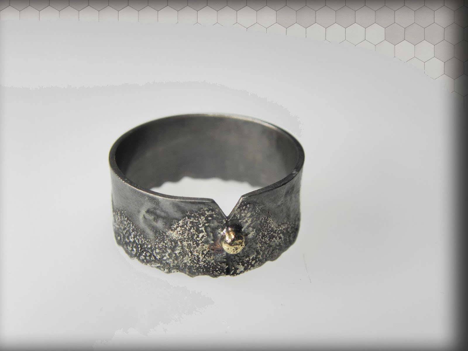 https://www.etsy.com/listing/177107744/silver-men-ring-with-14-k-yellow-gold?ref=related-0