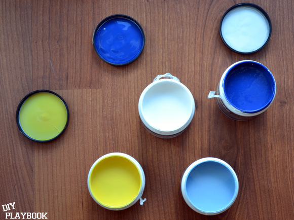 Paint samples: blue colors and a pop of yellow are perfect for this DIY outdoor rug.