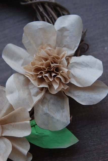 Hot glue your flower to your wreath, looking to vary the flower forms for more interest.