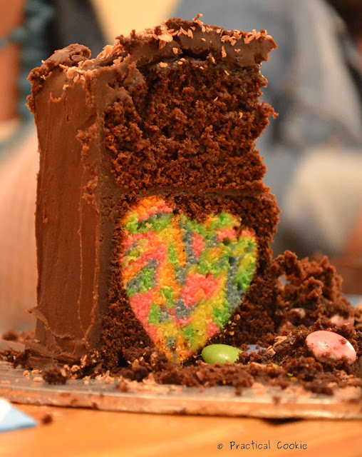 Chocolate cake with multicoloured heart in the middle