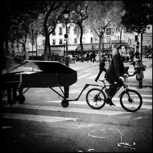 "Unidentified pianist pulls his piano to the concert hall Bataclan where he played a somber ""Imagine"" by John Lennon"