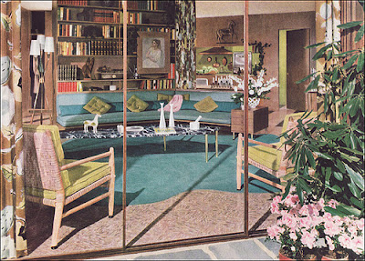 Mid-century living room with blue sofa and rug