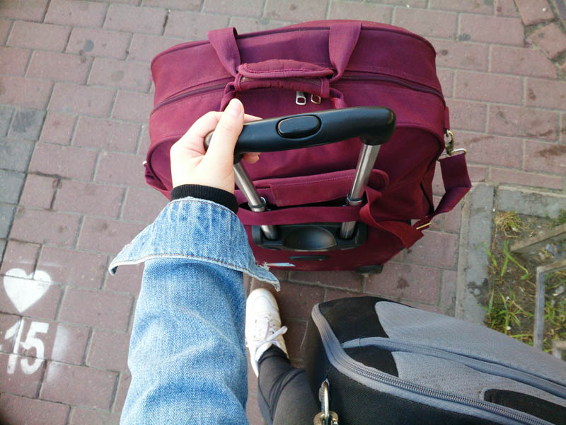 moving to another city alone suitcase