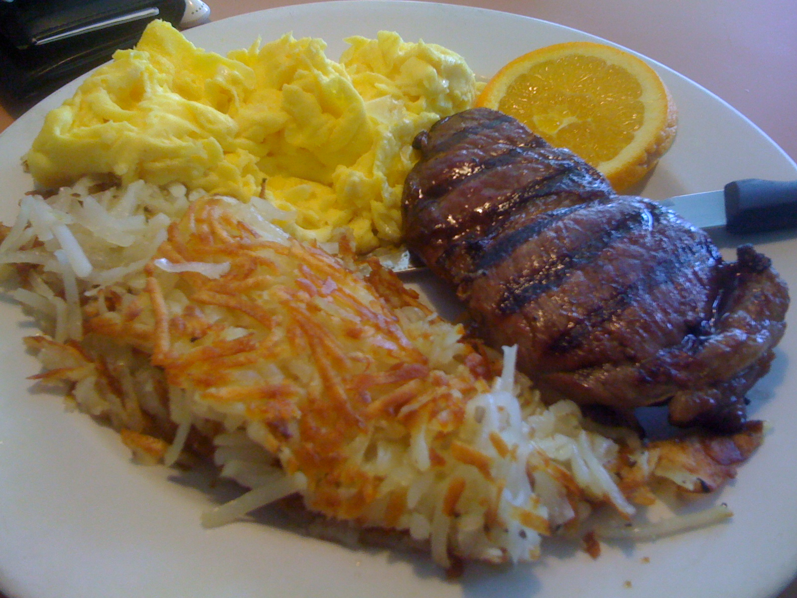 Sirloin steak, hash browns, and eggs