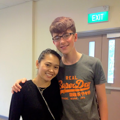 Greyson Chance greets a fan while wearing his new glasses