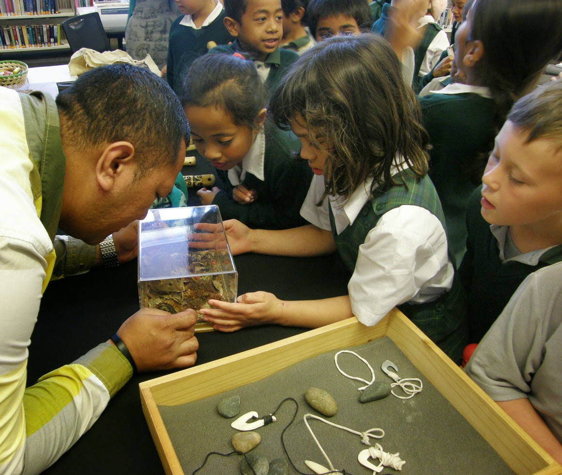 Kids interact with museum objects.