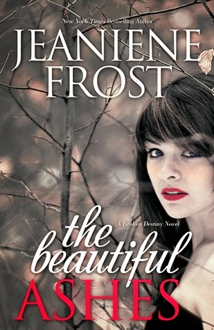 The Beautiful Ashes cover description: a woman with red lipstick stands in a grey forest. The cover is all in grey and red.