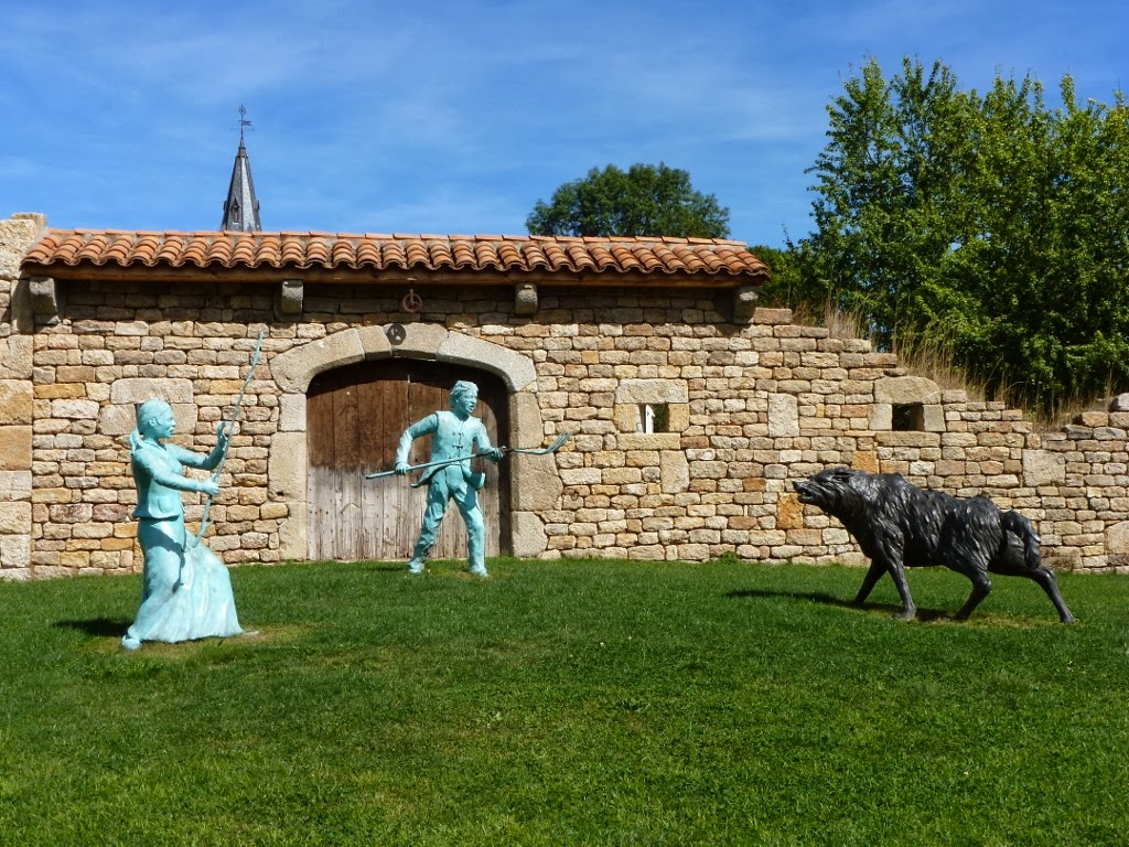 Statues of beast and peasants at Malzieu