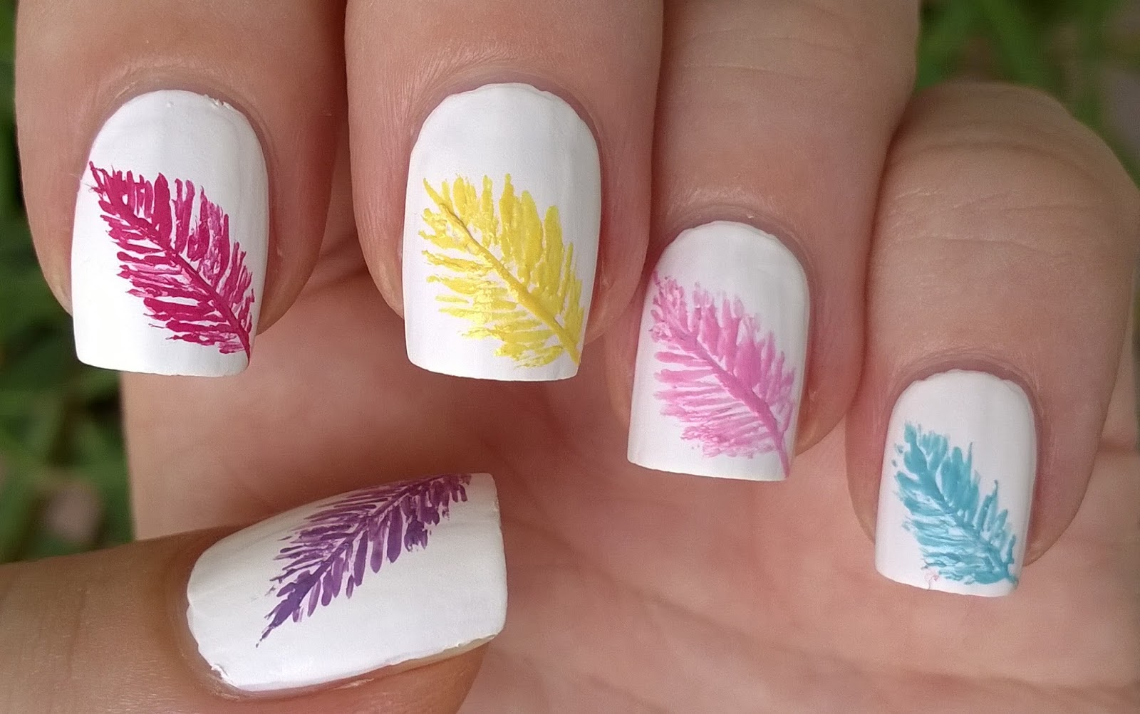 Life World Women: Matte White Nail Design With Colorful Feathers