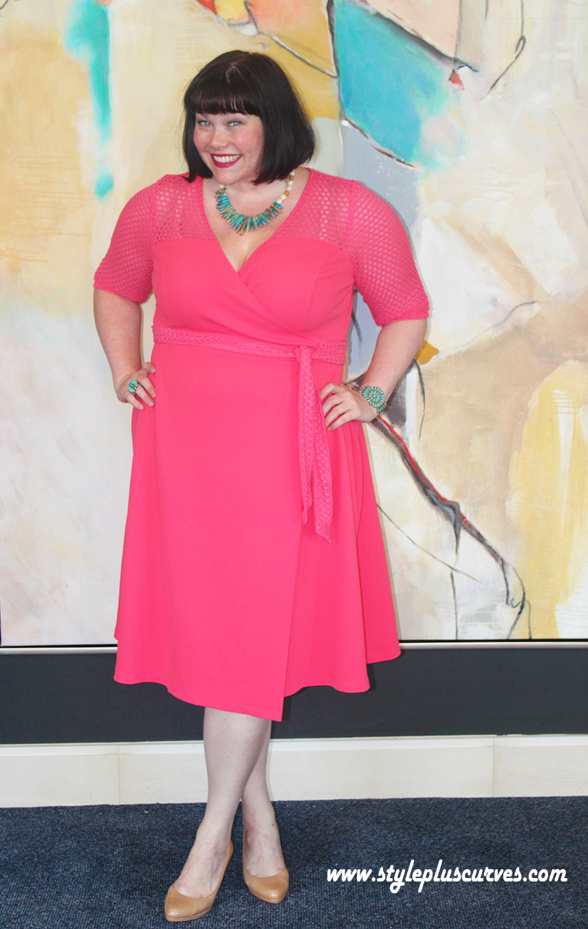 Plus Size Fashion Blogger Amber from Style Plus Curves in a coral plus size wrap dress from Kiyonna in Chicago