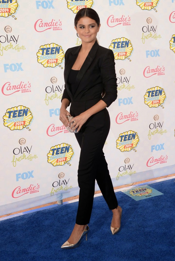 Selena Gomez wears a black Saint Laurent jumpsuit to the 2014 Teen Choice Awards