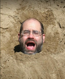 person buried in sand
