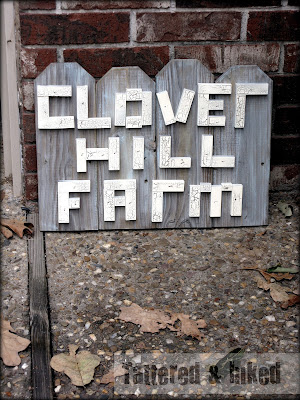 weathered wood farmhouse family name sign