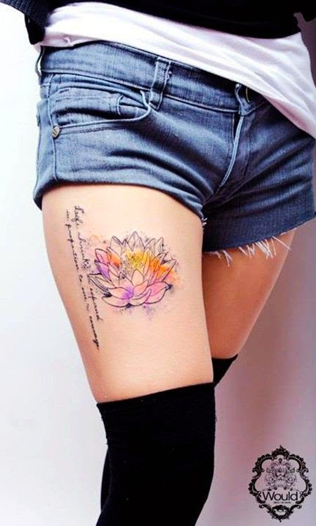 Lotus watercolor tattoo on girl's leg
